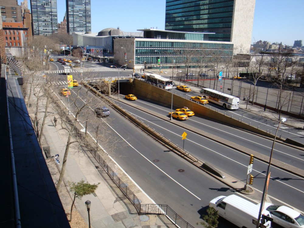 View of the existing site (wide sidewalk on left) from Tudor City.